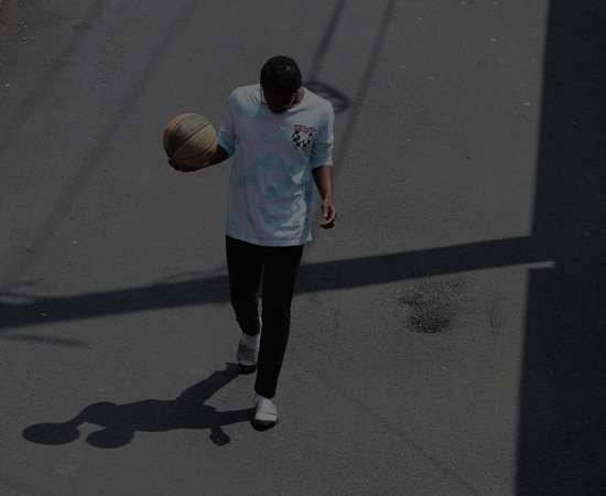 Youth walking down the street with a basketball